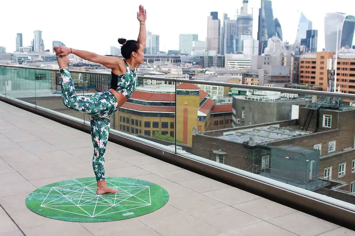 Person doing yoga on a balcony