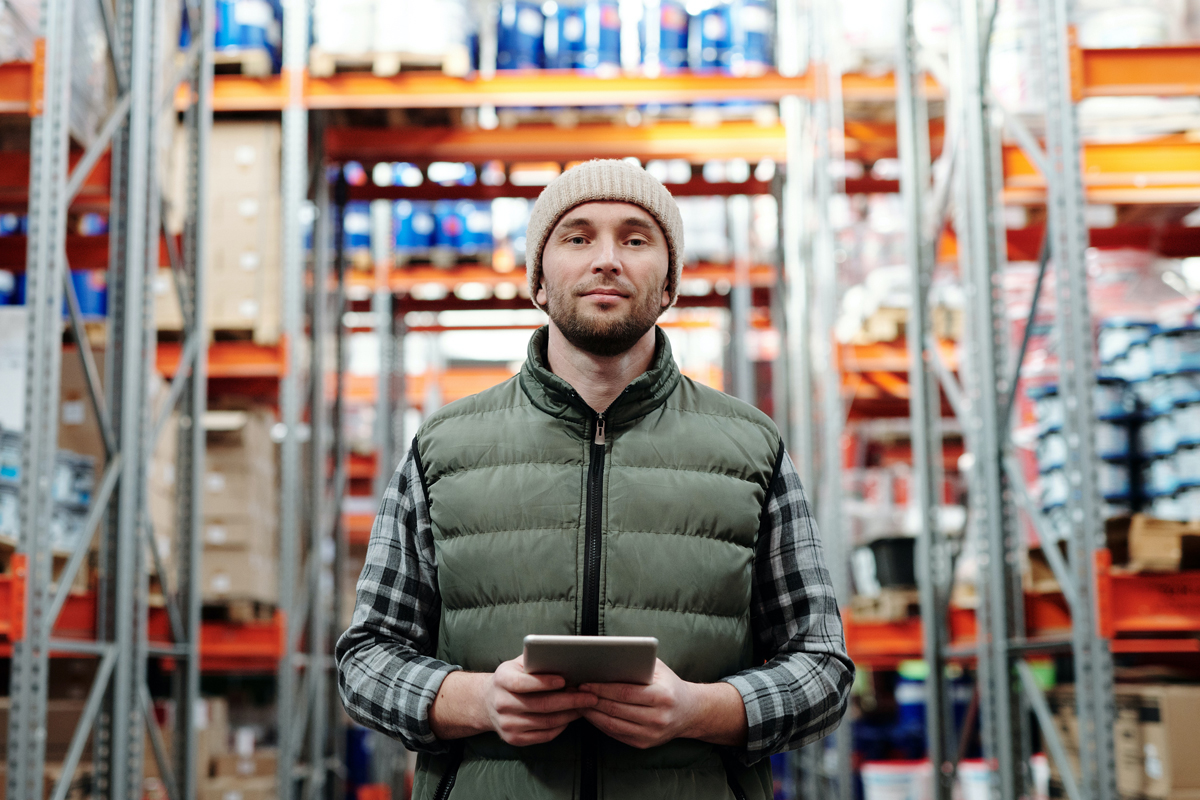 man with ipad in warehouse
