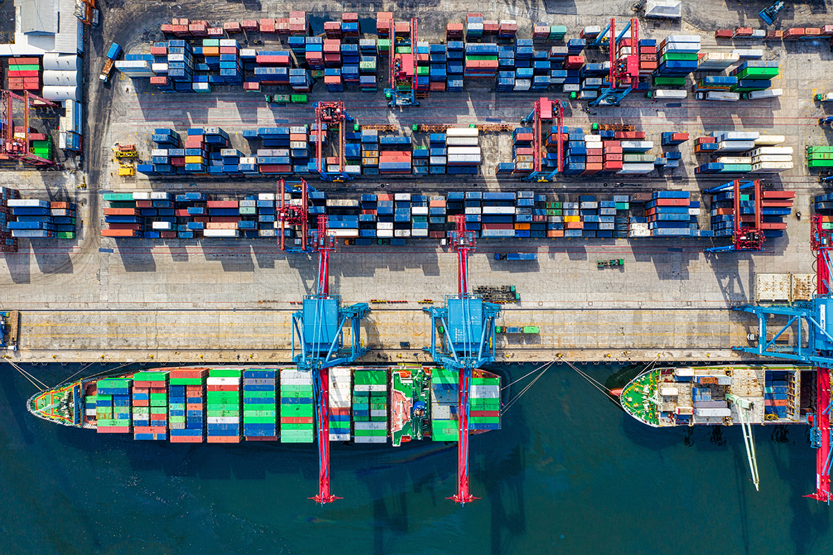 Bird's eye view of cargo ships and containers at a port
