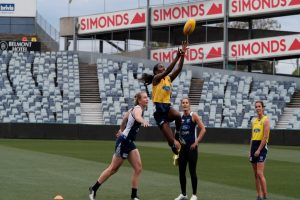 AFLW players training on oval