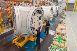 Engineers working on machines in warehouse