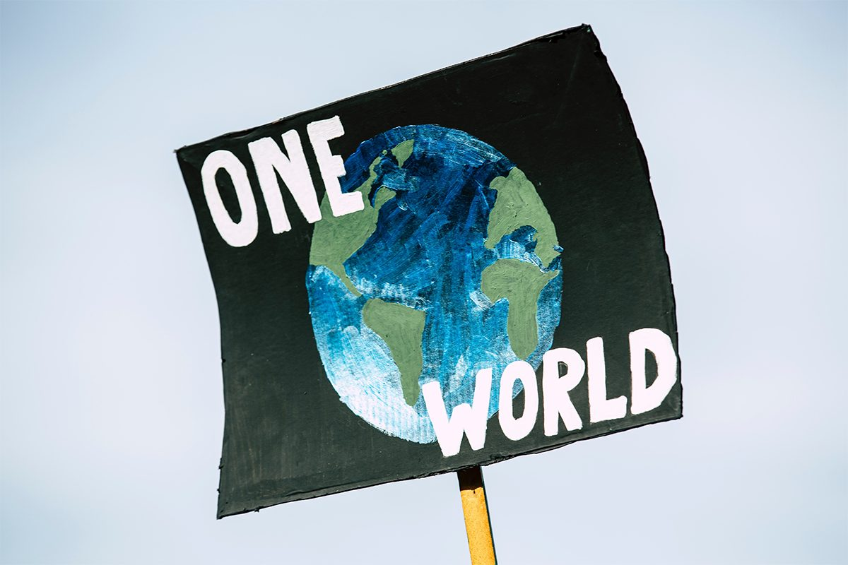 Poster with a painting of planet Earth and the words 'One World'